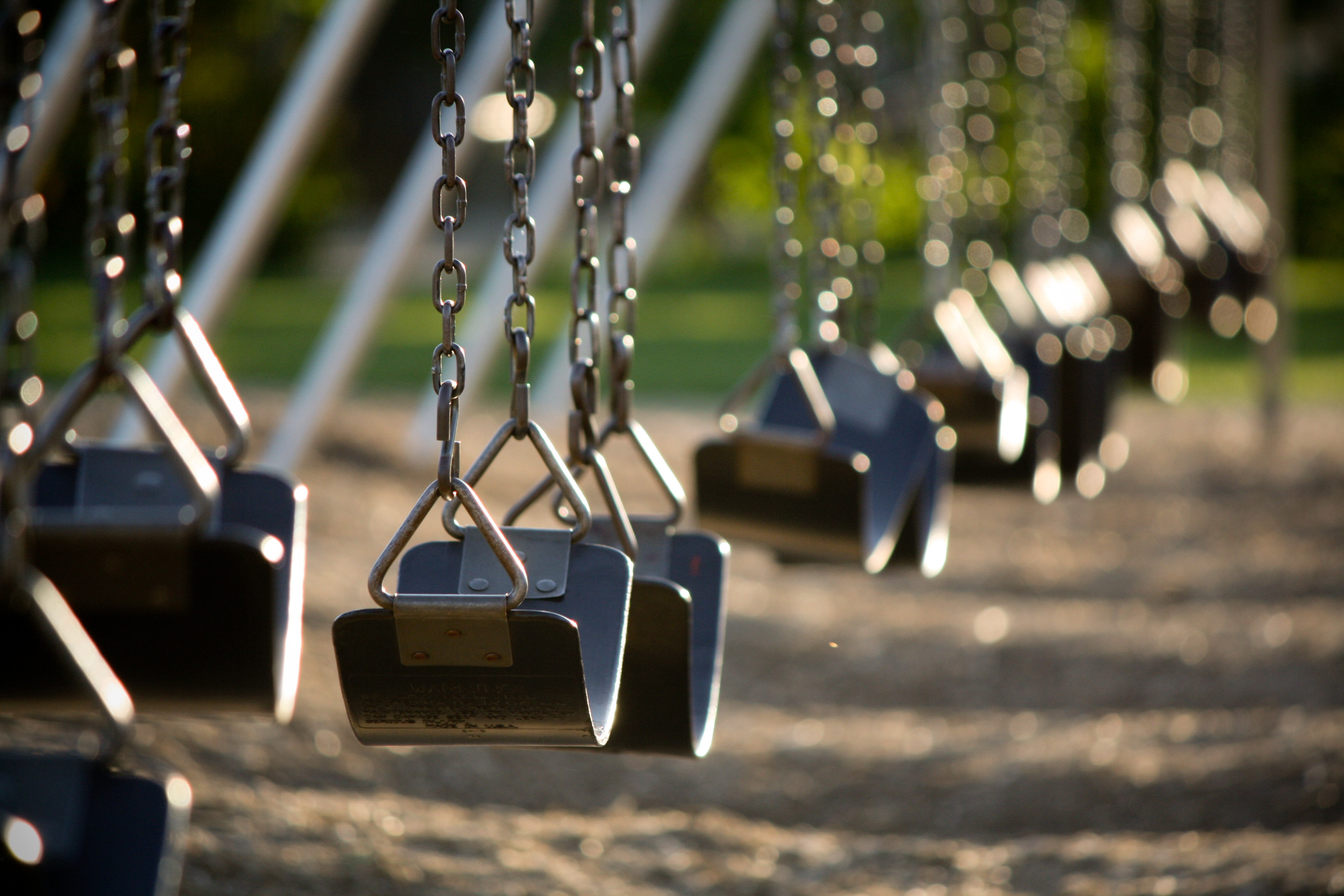 black swings at a playground
