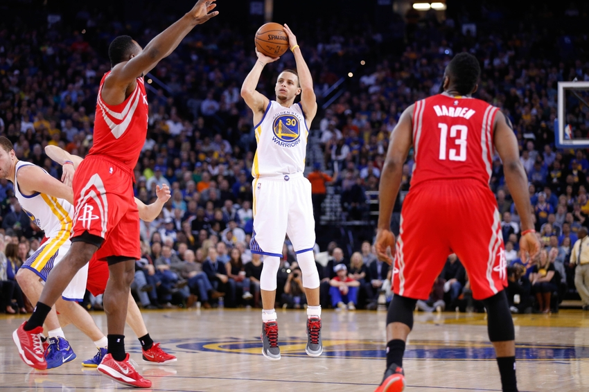 Jan 21, 2015; Oakland, CA, USA; Golden State Warriors guard Stephen Curry (30) shoots the ball against the Houston Rockets during the third quarter at Oracle Arena. The Warriors won 126-113. Mandatory Credit: Kelley L Cox-USA TODAY Sports